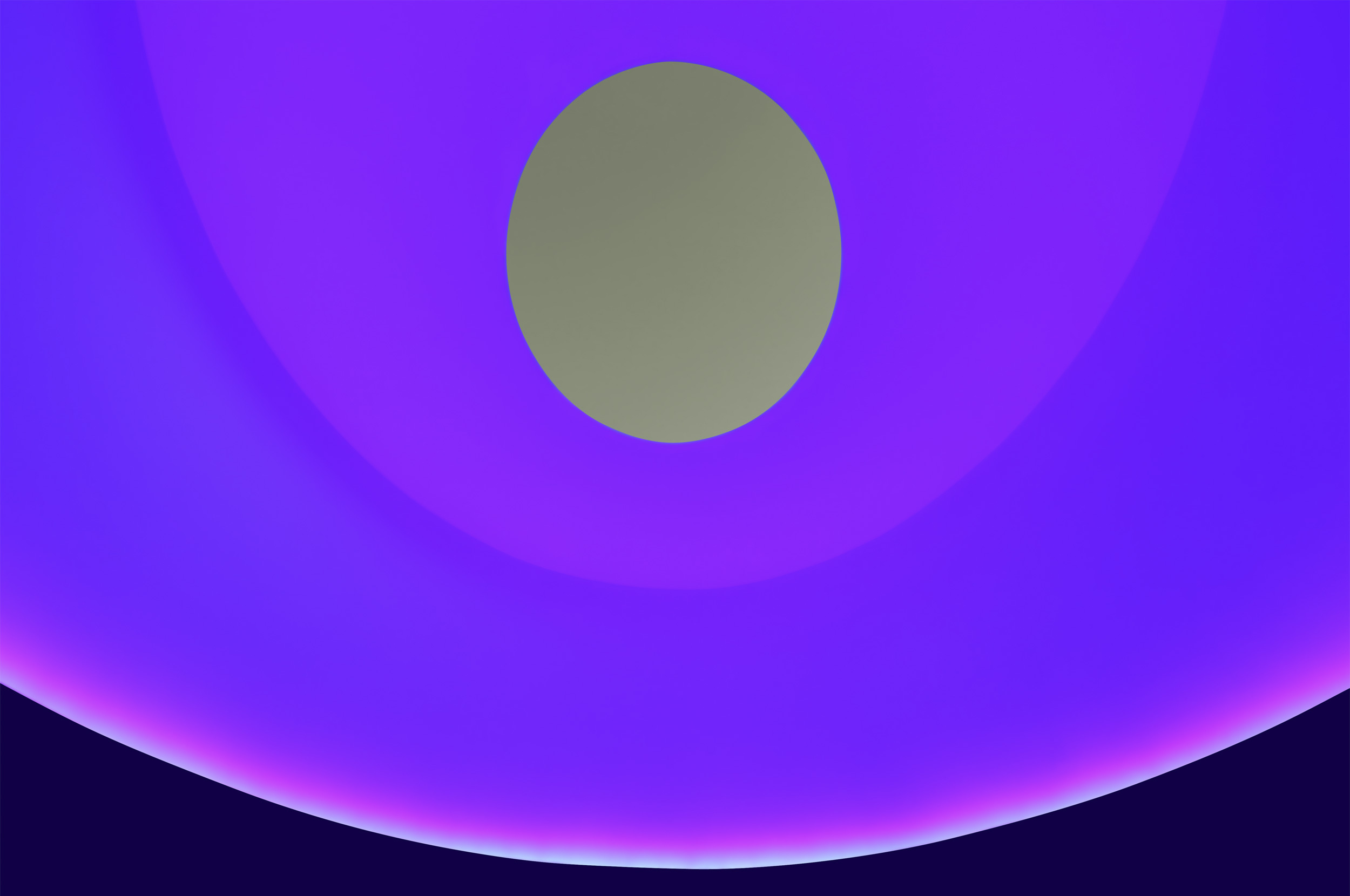 Photo of the ceiling colored with magenta and blue lights and a gray-green oculus.